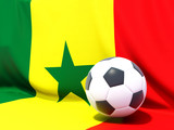 Flag of senegal with football in front of it