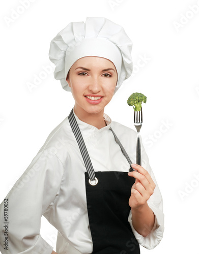 Pretty cook chief holding fork with salad