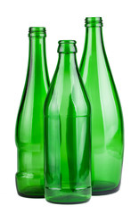 Three green empty bottles
