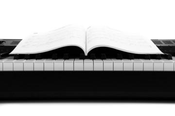 Piano keys and musical book