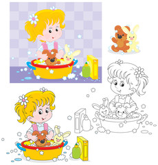 Little girl washing her toy bear and rabbit
