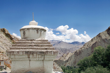 A beautiful ancient stupa with background of sedimentary rocks