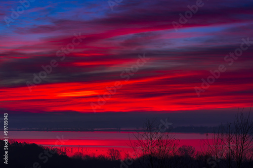 Crimson Sunrise Over the Lake