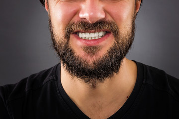 Closeup of  stressed man mouth isolated on gray background