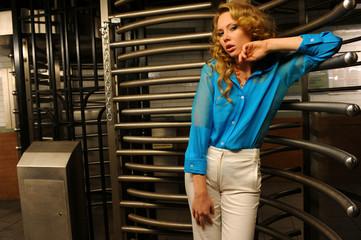 Glamor redhead model posing in front of revolving door