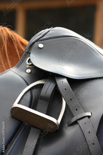 Close up of black saddle on horse back