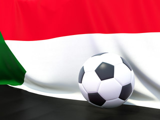 Flag of sudan with football in front of it