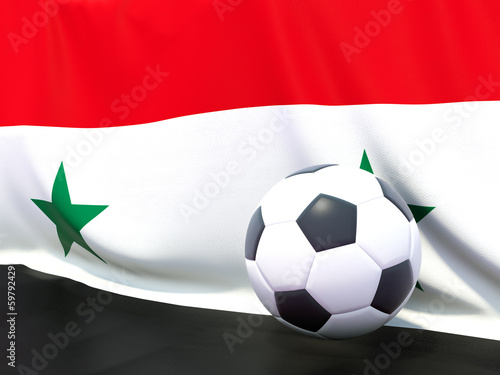 Flag of syria with football in front of it