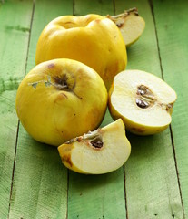 ripe yellow quince on a wooden table