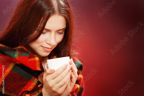woman covered with woolen plaid