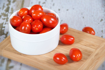 Fresh cherry tomatoes in white bowl