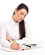 Young businesswoman signing documents at desk