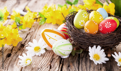 Easter colored eggs on wood