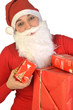 A Santa Claus distributes gifts