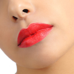 Close up of a woman lips detail painted on red