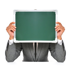 man in suit with a blank chalkboard