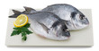 Fresh fish with slice of lemon and parsley on plate isolated