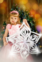 Little girl with Christmas snowflake