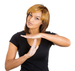 Serious woman showing a time out gesture