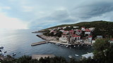 Clouds timelapse over village on a seashore, Croatia