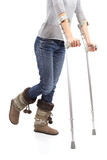Close up of a woman walking with crutches