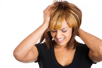 Woman stressed is going crazy pulling her hair in frustration