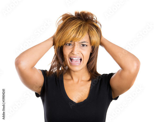 Upset stressed woman pulling out her hair