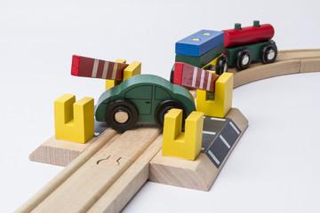 toy car on railroad crossing