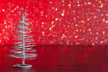 modern christmas tree on red tint light bokeh background