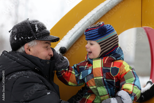 Happy family at winter playground