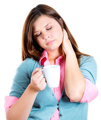 Sleepy woman holding a cup of coffee, falling asleep