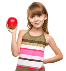 Little girl with red apple