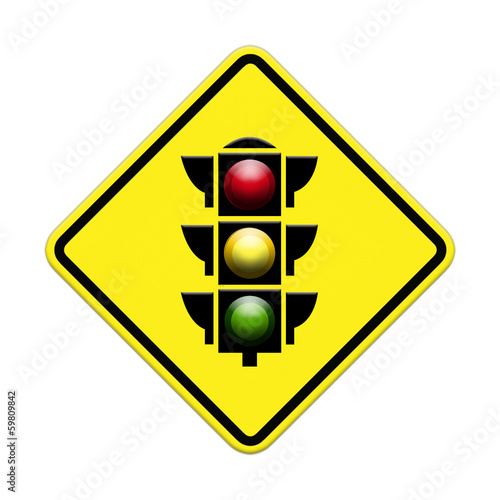 traffic light over yellow sign