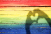 """Постер, картина, фотообои """"Hands Making Love Heart Shadow on Rainbow Background"""""""