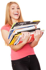 Student girl with a pile of heavy books