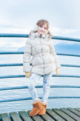 Outdoor portrait of a cute girl on a bridge
