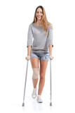 Front view of a woman walking with crutches