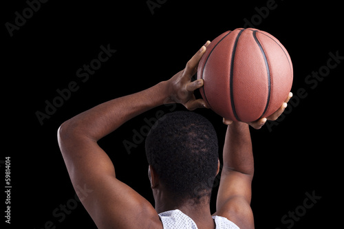 Basketball player against dark background