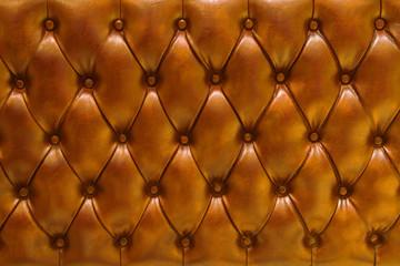 Fondo de textura de cuero natural acolchado en color naranja