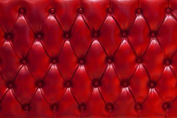 Fondo de textura de cuero natural acolchado en color rojo