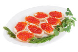 Tartlets with red caviar on plate isolated on white background.