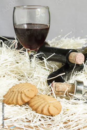 Crackers with glasses of red wine on fiber paper