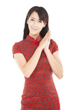happy chinese new year.beautiful chinese woman with wish gesture