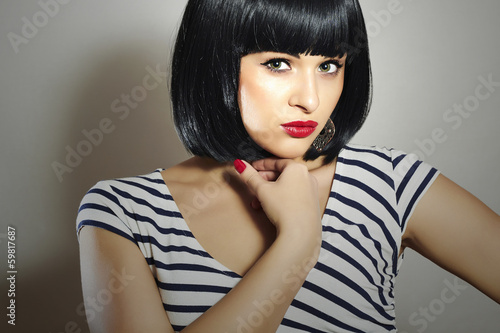 Beautiful Brunette Girl in Dress.Black Hair.bob Haircut.Red Lips