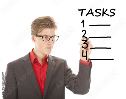 Young student writing tasks items isolated on white background