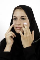 An Arab Girl Applying Facial Cream
