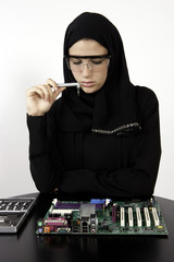 Arab Girl Wonders How To Fix Motherboard