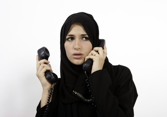 An Arab Receptionist Handling Too Many Phone Calls