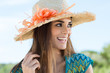 Young Woman Wearing Floral Straw Hat