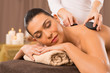 Hot Stone Massage Of A Young Woman